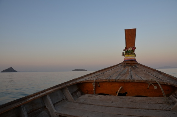 Ko Phi Phi, Thailand. Long tail boat sailing into the sunset. Photo: ©Slowaholic